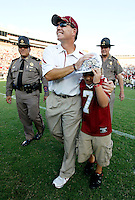 TALLAHASSEE, FL 9/18/10-FSU-BYU FB10 CH-Florida State Head Coach Jimbo Fisher gives his son Trey a squeeze as he walks off the field after the Seminoles beat Brigham Young 34-10 Saturday at Doak Campbell Stadium in Tallahassee. .COLIN HACKLEY PHOTO