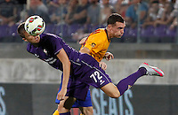 Calcio: amichevole Fiorentina vs Barcellona. Firenze, stadio Artemio Franchi, 2 agosto 2015.<br /> Fiorentina's Josip Ilicic, left, and FC Barcelona's Thomas Vermaelen fight for the ball during the friendly match between Fiorentina and FC Barcelona at Florence's Artemio Franchi stadium, 2 August 2015.<br /> UPDATE IMAGES PRESS/Riccardo De Luca