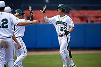 Dartmouth Big Green right fielder Matt Feinstein (23) hit fives teammates during a game against the Lehigh Mountain Hawks on March 20, 2016 at Chain of Lakes Stadium in Winter Haven, Florida.  Dartmouth defeated Lehigh 5-4.  (Mike Janes/Four Seam Images)