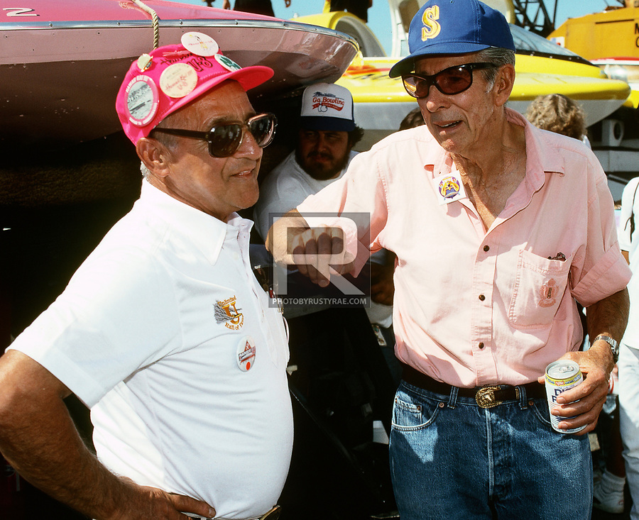 Two of the greats of the sport, Hawaii Kai and Miss Bardahl drive Jack Regas chatting with Ted Jones in the Seattle pits. RIP gentlemen.
