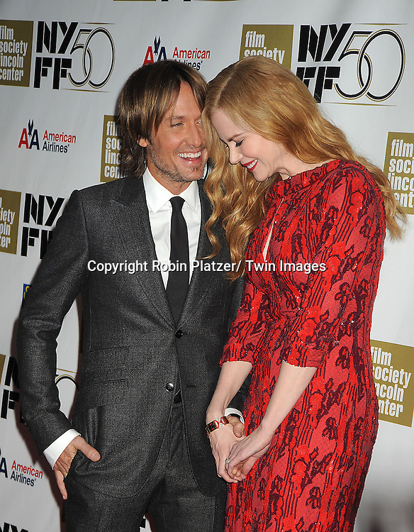 "Keith Urban and wife Nicole Kidman in L'Wren Scott red dress attends the Film Society of Lincoln Center Gala Tribute to Nicole Kidman and the US Premiere of ""The Paperboy"" at the 2012 New York Film Festival  on October 3, 2012 at Alice Tully Hall in New York City. The movie stars Nicole Kidman, Macy Gray, David Oyelowo and Naella Gordon and was directed by Lee Daniels."