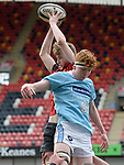 Ronan Corey of Ennis  in action against Cian Russell of Garryowen during their U-18 Munster Club Final at Thomond Park. Photograph by John Kelly.