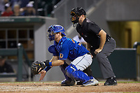 Durham Bulls catcher Mac James (28) prepares to receive a pitch as home plate umpire Brian Peterson looks on during the game against the Charlotte Knights at BB&T BallPark on July 31, 2019 in Charlotte, North Carolina. The Knights defeated the Bulls 9-6. (Brian Westerholt/Four Seam Images)