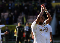 Pictured: Swansea captain Ashley Williams thanking supporters after the final whistle. Saturday 06 April 2013<br /> Re: Barclay's Premier League, Norwich City FC v Swansea City FC at the Carrow Road Stadium, Norwich, England.