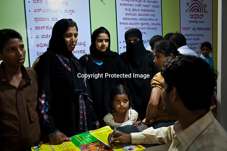 Residents enquire about the UID programme during the national identity enrollment process in Mysore city in Karnataka. Photograph: Sanjit Das/Panos