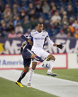 Kansas City Wizards forward Teal Bunbury (9) attempts to control the ball while closely defended by New England Revolution defender Darrius Barnes (25). The New England Revolution defeated Kansas City Wizards, 1-0, at Gillette Stadium on October 16, 2010.
