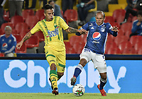 BOGOTA - COLOMBIA, 03-02-2019: Juan David Perez de Millonarios disputa el balón con Harold Gomez de Bucaramanga durante partido por la fecha 3 de la Liga Águila I 2019 entre Millonarios y Atlético Bucaramanga jugado en el estadio Nemesio Camacho El Campin de la ciudad de Bogotá. / Juan David Perez of Millonarios fights for the ball with Harold Gomez of Bucaramanga during match for the date 3 of the Liga Aguila I 2019 between Millonarios and Atletico Bucaramanga played at the Nemesio Camacho El Campin Stadium in Bogota city. Photo: VizzorImage / Gabriel Aponte / Staff.