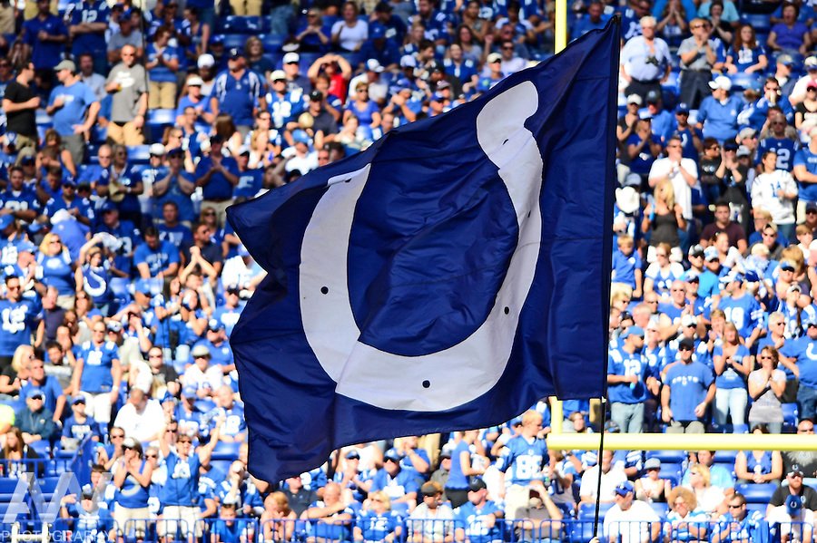 Sep 28, 2014; Indianapolis, IN, USA; Indianapolis Colts flag flown after a touchdown during the fourth quarter against the Tennessee Titans at Lucas Oil Stadium. Colts defeated the Titans 41-17. Mandatory Credit: Andrew Weber-USA TODAY Sports