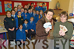 IN THE MONEY: 4th class pupils from Presentation Primary School helped to raise EUR1,600 for Sinead McCarthy who is currently in Eastern Africa helping poor children. From l-r were: Kay McCarthy,  and Sr. Celine.