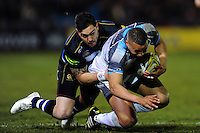 Marcus Watson of Newcastle Falcons is tackled to ground by Horacio Agulla of Bath Rugby. Aviva Premiership match, between Bath Rugby and Newcastle Falcons on March 18, 2016 at the Recreation Ground in Bath, England. Photo by: Patrick Khachfe / Onside Images