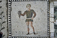 Detail of a mosaic of a man holding an amphora in the Villa of the Aviary, Carthage, Tunisia, pictured on January 27, 2008, in the afternoon. Carthage was founded in 814 BC by the Phoenicians who fought three Punic Wars against the Romans over this immensely important Mediterranean harbour. The Romans finally conquered the city in 146 BC. Subsequently it was conquered by the Vandals and the Byzantine Empire. Today it is a UNESCO World Heritage. The Roman Villa of the Aviary, with its octagonal garden set in a peristyle courtyard, is known for its fine mosaics depicting birds. Picture by Manuel Cohen.