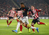 24th November 2019; Bramall Lane, Sheffield, Yorkshire, England; English Premier League Football, Sheffield United versus Manchester United; Marcus Rashford of Manchester United is tackled by Phil Jagielka  of Sheffield United with John Fleck  of Sheffield United close by - Strictly Editorial Use Only. No use with unauthorized audio, video, data, fixture lists, club/league logos or 'live' services. Online in-match use limited to 120 images, no video emulation. No use in betting, games or single club/league/player publications