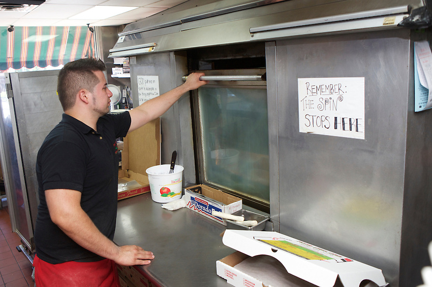 Hamilton, NJ - July 17, 2016: Luigi Severo, head pizza maker at Pizza Grill, home of the Corleone Style Pizza, a square pie made on a focaccia-like crust.<br /> <br /> CREDIT: Clay Williams for Edible Jersey.<br /> <br /> &copy; Clay Williams / claywilliamsphoto.com