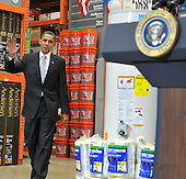 Alexandria, VA - December 15, 2009 -- United States President Barack Obama waves as he walks to the podium to make remarks discussing the economic impact of energy saving home retrofits with labor, manufacturing, and small business leaders during remarks at a Northern Virginia Home Depot store in Alexandria, Virginia on Tuesday, December 15, 2009..Credit: Ron Sachs - Pool via CNP