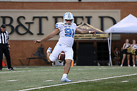 WINSTON-SALEM, NC - SEPTEMBER 13: Ben Kiernan #91 of the University of North Carolina punts the ball during a game between University of North Carolina and Wake Forest University at BB