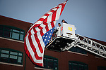 Firemen raise the United States Flag prior to the Quad Cities Marathon in 2010 in this photo.