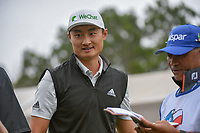 HaoTong Li (CHN) visits on the tee on 1 during day 3 of the Valero Texas Open, at the TPC San Antonio Oaks Course, San Antonio, Texas, USA. 4/6/2019.<br /> Picture: Golffile | Ken Murray<br /> <br /> <br /> All photo usage must carry mandatory copyright credit (© Golffile | Ken Murray)