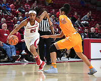 NWA Democrat-Gazette/J.T. WAMPLER Arkansas' Devin Cosper drives to the lane while Tennessee's Evina Westerbrook defends Thursday Feb. 8, 2018 at Bud Walton Arena in Fayetteville. Arkansas lost 90-85.
