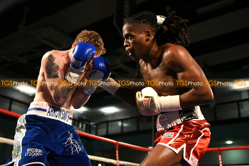 O'Shane Clarke (red shorts) defeats Dale Arrowsmith during a Boxing Show at the Westcroft Leisure Centre on 11th February 2017