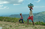 A woman and her son walk home from the market in Les Palmes, a rural village in southern Haiti where the Lutheran World Federation has been working with survivors of the 2010 earthquake, along with other residents, to experience more abundant life.