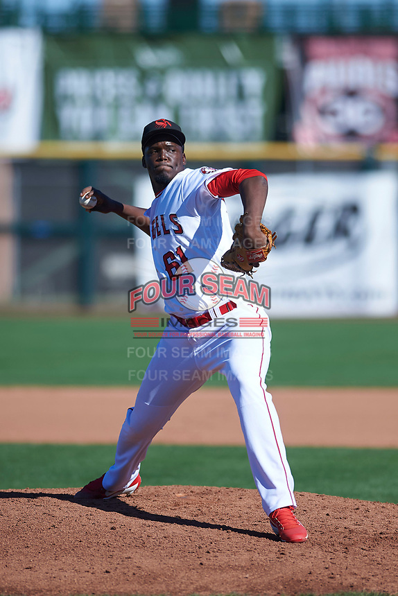Scottsdale Scorpions relief pitcher Samil De Los Santos (61), of the Los Angeles Angels organization, delivers a pitch to the plate during an Arizona Fall League game against the Surprise Saguaros on October 27, 2017 at Scottsdale Stadium in Scottsdale, Arizona. The Scorpions defeated the Saguaros 6-5. (Zachary Lucy/Four Seam Images)