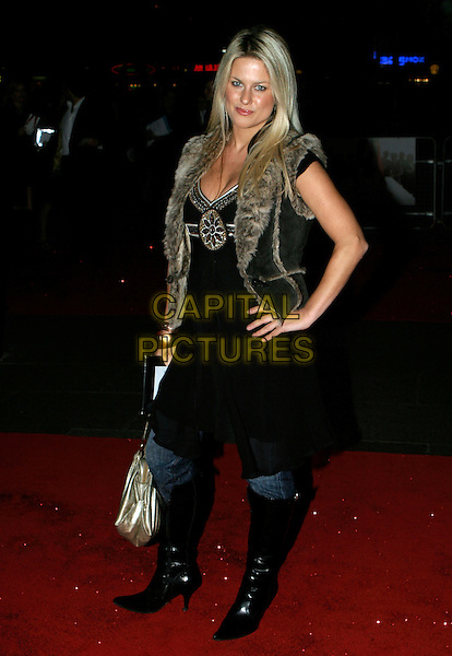 "GEORGINA BOUZOVA.UK Premiere of ""Kinky Boots"" at the Vue West End, Leicester Square, London..October 4th, 2005.full length hand on hip fur lined trim gilet vest black boots black dress over jeans denim.www.capitalpictures.com.sales@capitalpictures.com.© Capital Pictures."