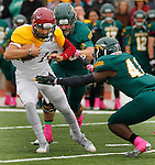 OCTOBER 4, 2014 -- Colorado Mesa quarterback Andrew Cota #10 tries to escape tacklers Boone Bowker #90 and Isaiah Jones #41 of Black Hills State during their Rocky Mountain Athletic Conference game Saturday at Lyle Hare Stadium in Spearfish, S.D.  (Photo by Dick Carlson/Inertia)