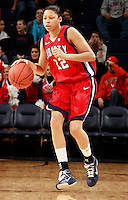 CHARLOTTESVILLE, VA- December 7: Danika Dale #12 of the Liberty Lady Flames handles the ball during the game against the Virginia Cavaliers on December 7, 2011 at the John Paul Jones arena in Charlottesville, Va. Virginia defeated Liberty 64-38. (Photo by Andrew Shurtleff/Getty Images) *** Local Caption *** Danika Dale