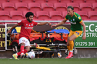 22nd July 2020; Ashton Gate Stadium, Bristol, England; English Football League Championship Football, Bristol City versus Preston North End; Jay Dasilva of Bristol City clears the ball under pressure  from Jordan Storey of Preston North End