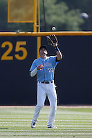 Kris Bryant #23 of the University of San Diego Toreros catches a fly ball during a game against the Cal State Northridge Matadors at Matador Field on March 26, 2013 in Northridge, California. (Larry Goren/Four Seam Images)