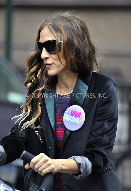 WWW.ACEPIXS.COM....October 24 2012, New York City....Actress Sarah Jessica Parker supoprts President Obama's re-election bid with a 'Viva Obama' badge as she takes twins Tabitha and Marion to play school on October 24 2012 in New York City....By Line: Curtis Means/ACE Pictures......ACE Pictures, Inc...tel: 646 769 0430..Email: info@acepixs.com..www.acepixs.com