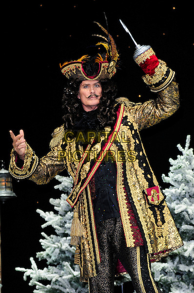 DAVID HASSELHOFF  .First Family Entertainment theatre company's annual group Pantomime photocall at Piccadilly Theatre, London, England..November 26th, 2010.stage costume panto pantomime half 3/4 length captain hook gold wig jacket hat hands arms.CAP/CAS.©Bob Cass/Capital Pictures.