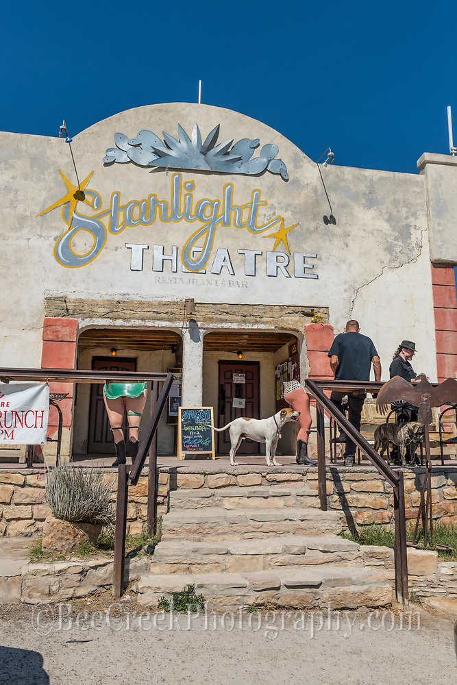 Starlight Front porch in Terlingua located in far west Texas near Big Bend parks. Another day and a couple of local people milling about in front of the Starlight Theatre front porch with dogs in tow.