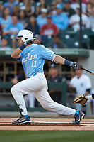 Cody Roberts (11) of the North Carolina Tar Heels follows through on his swing against the South Carolina Gamecocks at BB&T BallPark on April 3, 2018 in Charlotte, North Carolina. The Tar Heels defeated the Gamecocks 11-3. (Brian Westerholt/Four Seam Images)