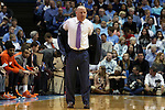 18 January 2015: Virginia Tech head coach Buzz Williams takes off his coat. The University of North Carolina Tar Heels played the Virginia Tech University Hokies in an NCAA Division I Men's basketball game at the Dean E. Smith Center in Chapel Hill, North Carolina. UNC won the game 68-53.