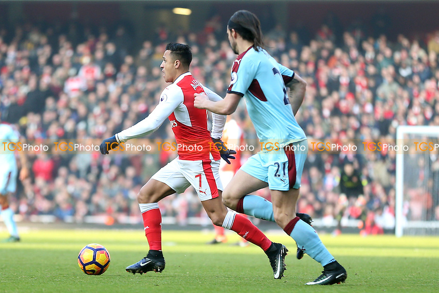 Alexis Sanchez of Arsenal and George Boyd of Burnley during Arsenal vs Burnley, Premier League Football at the Emirates Stadium on 22nd January 2017