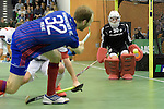 GER - Muelheim an der Ruhr, Germany, February 05: During the FinalFour final men hockey match between Rot-Weiss Koeln (whize) and Mannheimer HC (blue) on February 5, 2017 at innogy Sporthalle in Muelheim an der Ruhr, Germany. (Photo by Dirk Markgraf / www.265-images.com) *** Local caption *** Fabian Pehlke #32 of Mannheimer HC scores the leading goal 1-2, Victor Aly #30 of Rot-Weiss Koeln