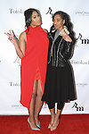 Keisha Sullivan (left) and Bree Anderson attend the 3rd Annual Wives' Holiday Soiree at Totokaelo in SOHO on December 9, 2015.