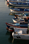 Fishing boats moored to jetty, Corralejo harbour,Fuerteventura,Canary Islands,Spain,