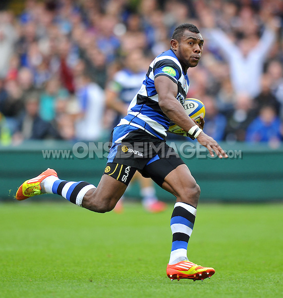 Semesa Rokoduguni runs in a try. Pre-season friendly match, between Bath Rugby and Bristol Rugby on August 17, 2013 at the Recreation Ground in Bath, England. Photo by: Patrick Khachfe / Onside Images
