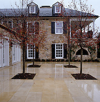 Salamander Farm; the elegant colonial style of the building is complemented by the sympathetic modern terrace and understated planting