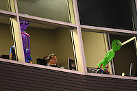 Tulsa Drillers press hold up alien blow up toys out the window of the press box during the second game of a doubleheader against the Frisco Rough Riders on May 29, 2014 at ONEOK Field in Tulsa, Oklahoma.  Frisco defeated Tulsa 3-2.  (Mike Janes/Four Seam Images)