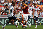 Calcio, Serie A: Roma-Bologna. Roma, stadio Olimpico, 16 settembre 2012..AS Roma forward Erik Lamela, of Argentina, center, fights for the ball against Bologna players during the Italian Serie A football match between AS Roma and Bologna, at Rome, Olympic stadium, 16 September 2012. .UPDATE IMAGES PRESS/Isabella Bonotto