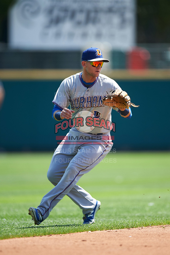 Durham Bulls shortstop Jake Hager (2) fields a ground ball during a game against the Rochester Red Wings on July 20, 2016 at Frontier Field in Rochester, New York.  Rochester defeated Durham 6-2.  (Mike Janes/Four Seam Images)