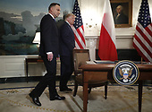 US President Donald J. Trump (R) and Polish President Andrzej Duda (L) arrive to participate in a signing ceremony in the Diplomatic Reception Room of the White House in Washington, DC, USA, 12 June 2019. President Trump and President Duda signed an agreement to increase military to military cooperation including the purchase of F-35 fighter jets by Poland and an increased US troop presence in Poland. <br /> Credit: Shawn Thew / Pool via CNP