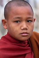 Myanmar, Burma.  Young Burmese Boy Buddhist Monk, Alodaw Pauk Pagoda, Nampan Village, Inle Lake, Shan State.