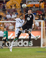 Houston Dynamo midfielder Ricardo Clark (13) and D.C. United midfielder Santino Quaranta (25) go up for the header.  Houston Dynamo tied D.C. United 0-0 at Robertson Stadium in Houston, TX on October 12, 2008.  Photo by Wendy Larsen/isiphotos.com