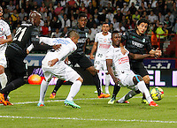 MANIZALES -COLOMBIA-22-03-2014. Hanyer Mosquera (Izq) de Once Caldas disputa el balón con Sherman Cardenas (Der) del Atletico Nacional en partido por la fecha 12 de la Liga Postobón I 2014 jugado en el estadio Palogrande de la ciudad de Manizales./ Once Caldas player Hanyer Mosquera (L) fights for the ball with Atletico Nacional player Sherman Cardenas (R) during match valid for the 12th date of the Postobon League I 2014 played at Palogrande stadium in Manizales city.  Photo: VizzorImage/Santiago Osorio/STR