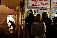 Min Yamaguchi takes a final nightly inventory in preparation for closing at the Oxnard Buddhist Temple food booth at the Ventura County Fair at Seaside Park in Ventura Calif., on the evening of Wednesday, Aug. 9, 2006. For over 30 years the booth has been the Temple's biggest fund raiser.  According to Yamaguchi,It keeps him so busy,  the next morning he hadn't remembered being approached for the photograph. (Photo by Bryce Yukio Adolphson/Brooks Institute of Photography, &copy;2006)<br />
