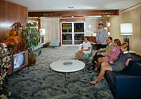 Dressed up couples watching television in the Admiral Motel lobby. Doo Wop photograph from the 1960's.